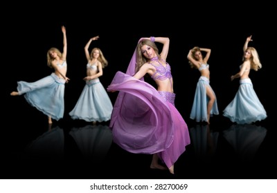Attractive east girls dances isolated on a black background