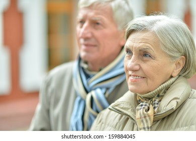 attractive elderly couple on a walk fall