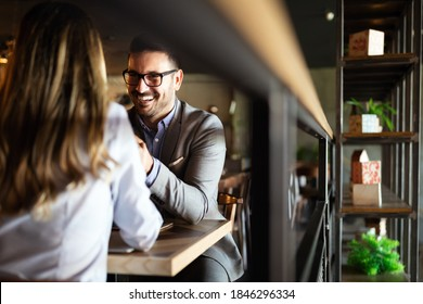 Attractive elegant young couple in love dating at the restaurant.