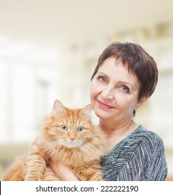 attractive emotional woman 50 years old with red cat