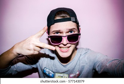 Attractive emotional  young man with glasses in studio