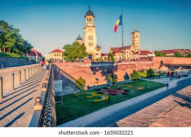 Attractive evening view of bell tower of Reunification Cathedral, Fortified churches inside Alba Carolina Fortress. Sunny summer scene of Transylvania, Alba Iulia city, Romania, Europe.