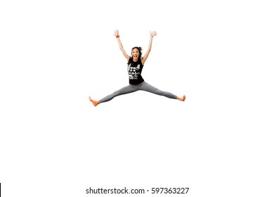 Attractive excited fitness girl in sportwear jumping trampoline isolated on white background