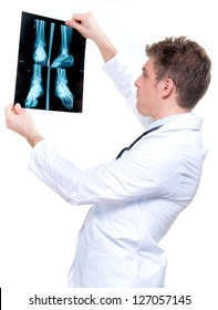 attractive and expressive cheerful doctor holding an foot x-ray