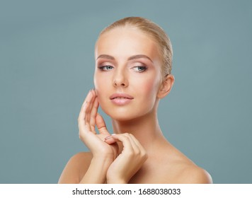 Attractive face of beautiful girl. Close-up portrait of healthy woman. Skin care, cosmetics, makeup, complexion and face lifting.