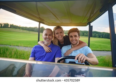 Attractive family in their golf cart
