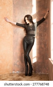 Attractive fashion woman in black leather pants