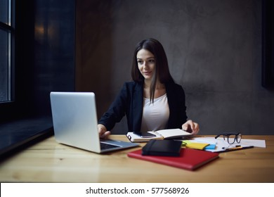 Attractive female administrative manager of restaurant chatting with marketing experts planning to set advertising campaign on websites searching company to place service in the hands of customers
