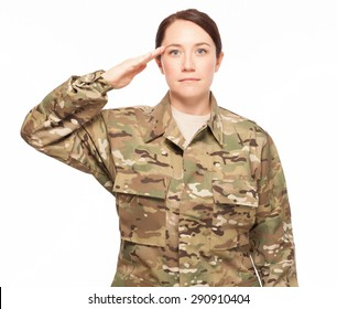 Attractive female Army soldier saluting while wearing multicam camouflage on white background.