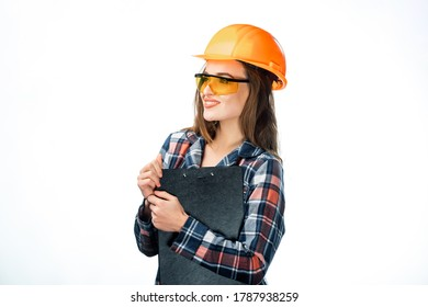 Attractive female builder holding professional documents. Isolated on white background.