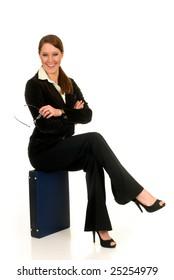 Attractive female businesswoman with briefcase.  studio shot.