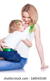 Attractive female with cute baby girl, closeup portrait of young mother hug her little daughter, studio shot, happy family, child care and love concept