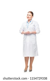 attractive female doctor in white coat looking at camera isolated on white background