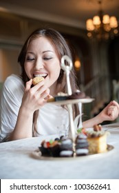 Attractive Female Eating Desserts