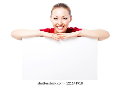 Attractive Female with a happy smile holding a white sign