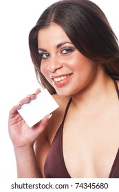 Attractive female holding a business card.