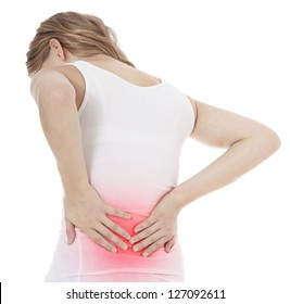 Attractive female person suffers from backache. All on white background.