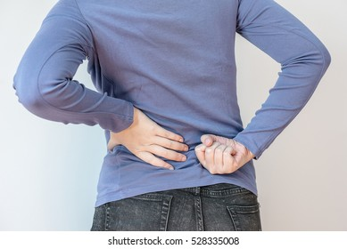 Attractive female person suffers from backache
