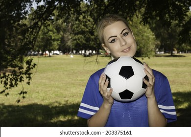 attractive female with soccer ball