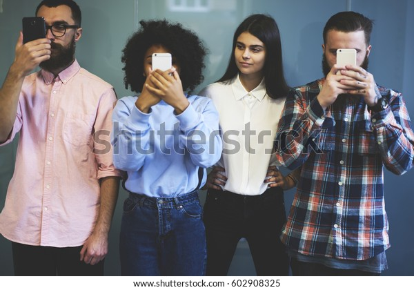 Attractive female student staying without social networks masks haven't addiction to smartphone and internet staying in real word inspire of her friends communicating only on web pages and sites