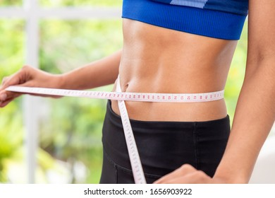 Attractive female woman torso with measuring tape, weight control and dieting concept