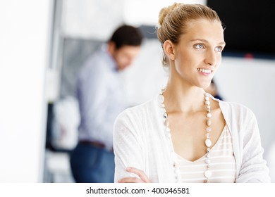Attractive female worker in office