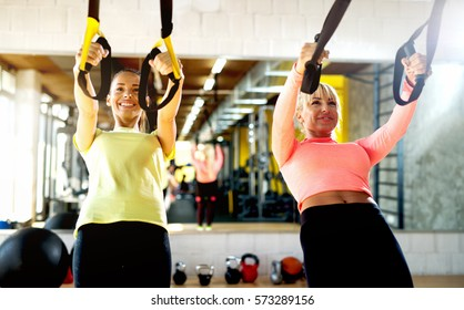 Attractive females working out at the gym.
