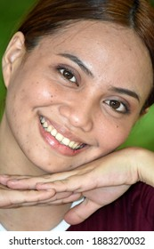 An Attractive Filipina Female Smiling