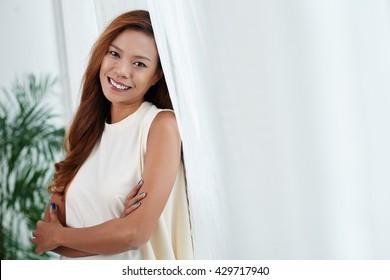 Attractive Filipino woman smiling and looking at camera