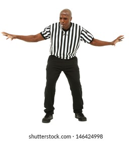 Attractive fit black man in referee uniform facing front and blowing whistle.