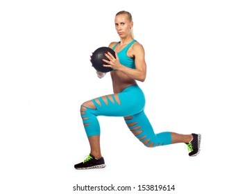 attractive fit blond woman athlete working with medicine ball