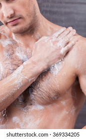 Attractive fit guy is taking a shower