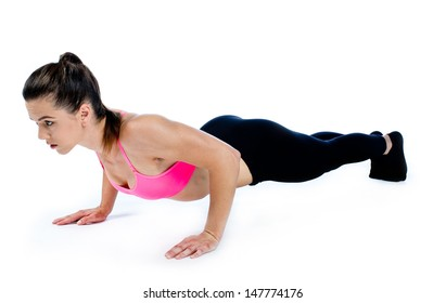 attractive fit woman doing push ups isolated