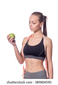 attractive fitness model with measuring tape on a white background