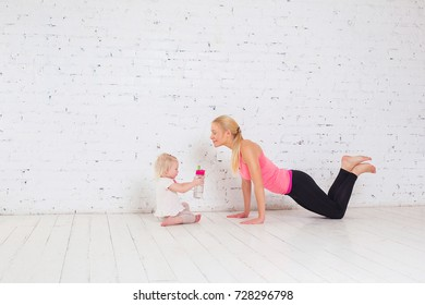 attractive fitness woman mother and baby gymnastics yoga exercises trained female body lifestyle white background
