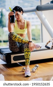 attractive fitness woman tired after workout drinks protein shake.Sexy fitness model resting after workout exercises in gym. fitness exhausted female with protein shaker.  - Shutterstock ID 1950152635