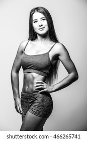 attractive fitness woman, trained female body. Black and white photo.