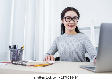 Attractive fmale designer working in office