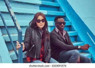 Attractive friend couple. African-American guy and Caucasian fem