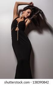 Attractive friendly brunette pose in studio.