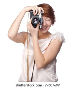 Attractive funny girl with a camera over white background
