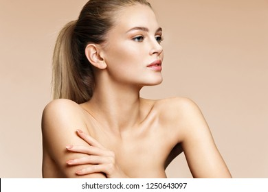 Attractive girl with beautiful make up on beige background. Youth and skin care concept