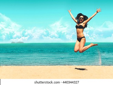Attractive Girl in Bikini Jumping on the Beach Having Fun, Summer vacation holiday Lifestyle. Happy women jumping freedom on white sand.