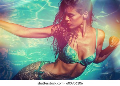 attractive  girl in bikini in pool hot summer day