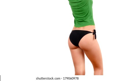 Attractive girl in black bikini and a green top posing with the back showing her curves. Sexy girl butt. Isolated on white.