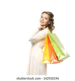Attractive girl with the bright shopping bag