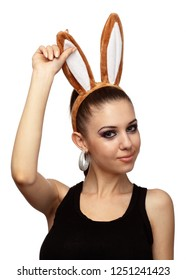 Attractive girl with bunny ears isolated over white