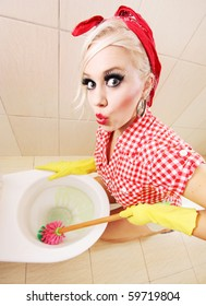 Attractive girl cleaning toilet, similar available in my portfolio