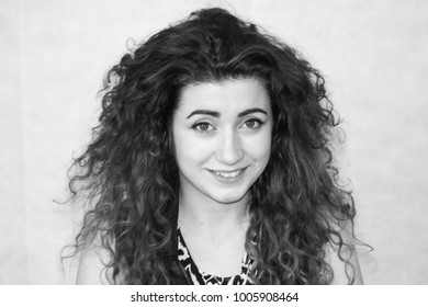 attractive girl. curly-haired girl. photo for your design. black and white photography. monochrome.portrait. curly haired