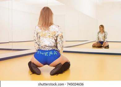 Attractive girl dancing twerk in the dance class